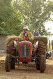 Grant-father Farmer. Grant-father and grant-daughter driving on tractor and wagon Stock Photo