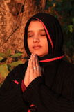 Grant me a lasting peace. A smart Muslim woman offering a prayers for granting her a lasting peace Stock Photos