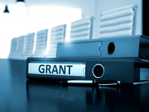 Grant na pasta do escritório Imagem tonificada 3d Fotografia de Stock Royalty Free