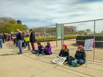 Demonstrators take a break at the March for Science in Chicago. royalty free stock image