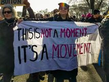 """Women's March. Woman holding """"It's a Movement"""" banner. GRANT PARK, CHICAGO-January 20, 2018. Women's March. A woman holds a banner that Stock Image"""