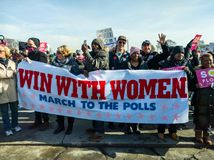 2018 Women`s March in Chicago. A group banner supports voting. GRANT PARK, CHICAGO-January 20, 2018. Women`s March. A group of demonstrators display a banner Royalty Free Stock Photo