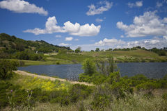 Grant Ranch Lake. This image was taken at Grant Ranch located in San Jose, California. The park offers many miles of hiking, fishing, and camping in the park royalty free stock photography