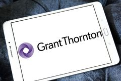Grant Thornton professional services company logo. Logo of Grant Thornton company on samsung tablet. Grant Thornton is the world fifth largest professional stock image