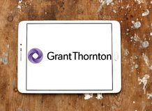 Grant Thornton professional services company logo. Logo of Grant Thornton company on samsung tablet. Grant Thornton is the world fifth largest professional royalty free stock images