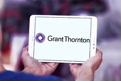 Grant Thornton professional services company logo. Logo of Grant Thornton company on samsung tablet. Grant Thornton is the world fifth largest professional stock images