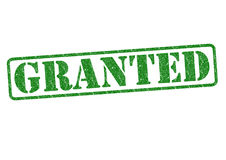 GRANTED. Green rubber stamp over a white background Stock Photography