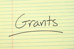 Grants On A Yellow Legal Pad Royalty Free Stock Images