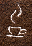 Granular coffee and cup. Granular brown coffee texture with drawn cup inside Stock Image