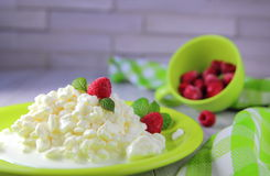 Granular  cottage cheese  with  cream. And fresh raspberries Stock Photo