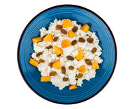 Granular curd in blue glass plate with peaches and raisins Stock Photography