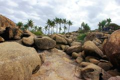 Rocks and Boulders. At a granular level, rocks are composed of grains of minerals, which, in turn, are homogeneous solids formed from a chemical compound that is stock photography
