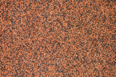 Granular texture of a Slab of Red Polished Granite Stock Photo