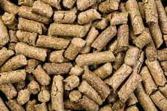 Granulated animal food background texture. On black Royalty Free Stock Photography