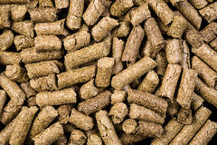 Granulated animal food background texture. Isolated on black Royalty Free Stock Images