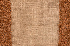 Granulated coffee lying on sackcloth. With space for text Royalty Free Stock Images