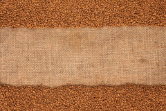 Granulated coffee lying on sackcloth. With space for text Stock Image
