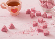 Granulated pink sugar  in the shape of heart Stock Images