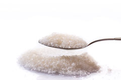 Granulated sugar in a spoon Royalty Free Stock Images