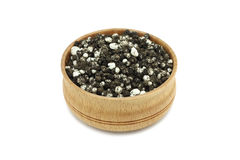 Granule fertilizer and humus in a wooden bowl Stock Image