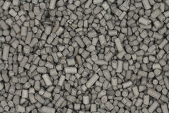 Granules of activated carbon black  background Stock Photo