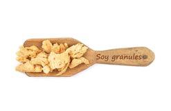 Granules de soja sur la pelle image libre de droits