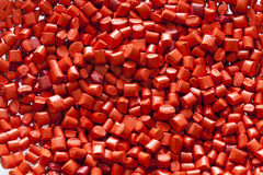 Granules en plastique rouges Photos libres de droits