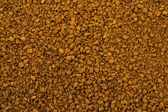 Granules of instant coffee background Royalty Free Stock Image