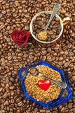 Granules of instant coffee background. Instant coffee in a glass dish. Preparation of soluble coffee. Decorate store coffee. Granules of instant coffee Royalty Free Stock Photos