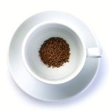 Granules of instant coffee in cup Royalty Free Stock Photos