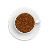 Granules of instant coffee in a white cup Stock Photography