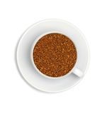 Granules of instant coffee in a white cup Royalty Free Stock Image