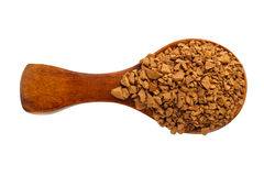 Granules of instant coffee in a wooden spoon isolated. Top view Stock Images