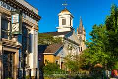 Granville institutions. GRANVILLE, OH - MAY 15, 2017: A bank, two churches, and a small historical museum, fill the south side of Broadway Avenue in this Stock Images