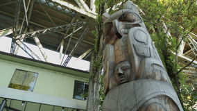 Granville Island, Vancouver Totem Pole dolly shot stock footage