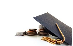Grap cap and coins Stock Photos