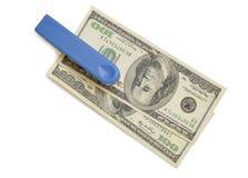 Grapadora con la pila de dólares Imágenes de archivo libres de regalías