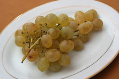 Grape. Bunch of grapes, yellow plate, studio shot Royalty Free Stock Photo