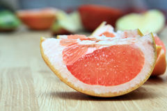 Grape. Lobule of grapefruit on a table Stock Images