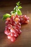 Grape. Still shot on grape with mood lighting on wooden texture Stock Image