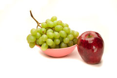 A grape and an apple Stock Photo