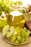 Grape and apple juice Royalty Free Stock Image