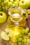 Grape and apple juice Royalty Free Stock Photos