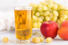 Grape and apple juice Royalty Free Stock Photos