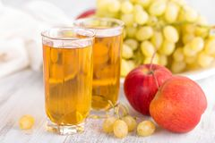Grape and apple juice. And fresh fruits Royalty Free Stock Images