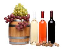 Grape, barrel, corks, corkscrew, bottles of wine Stock Images