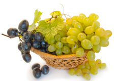 Grape in a basket. Bunch of raw grape in a basket isolated over white background Royalty Free Stock Photos