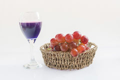 Grape on the basket. Isolate on white background stock photography