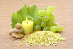 Grape bath. Bath salt pebbles and fresh grapes - aromatic bath Royalty Free Stock Photography