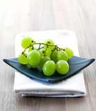 Grape on blue bowl Royalty Free Stock Photography